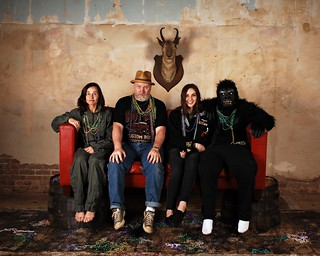 Portrait with a Stunt Photographer, a Sailor and a Rare White Footed Mountain Gorilla on a Red Sofa supported by Whiskey Barrels with Harry Connick Jr. playing Next Door.