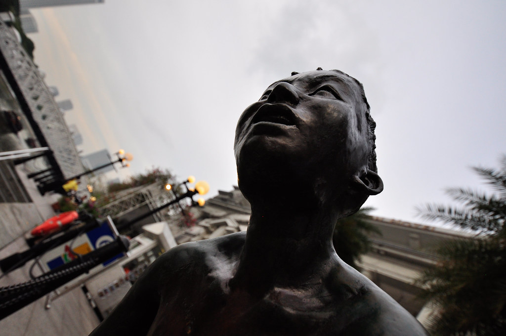 Boat quay pier boys jumping into river statue ...