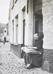 A lace maker in Bruges
