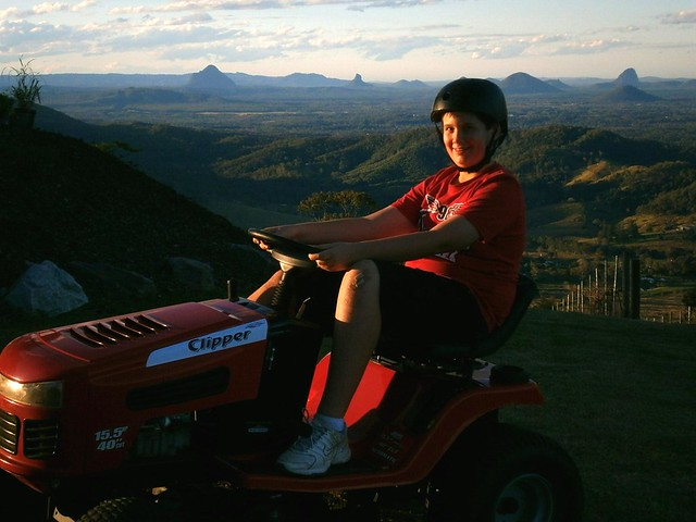 Harrison Riding the Mower