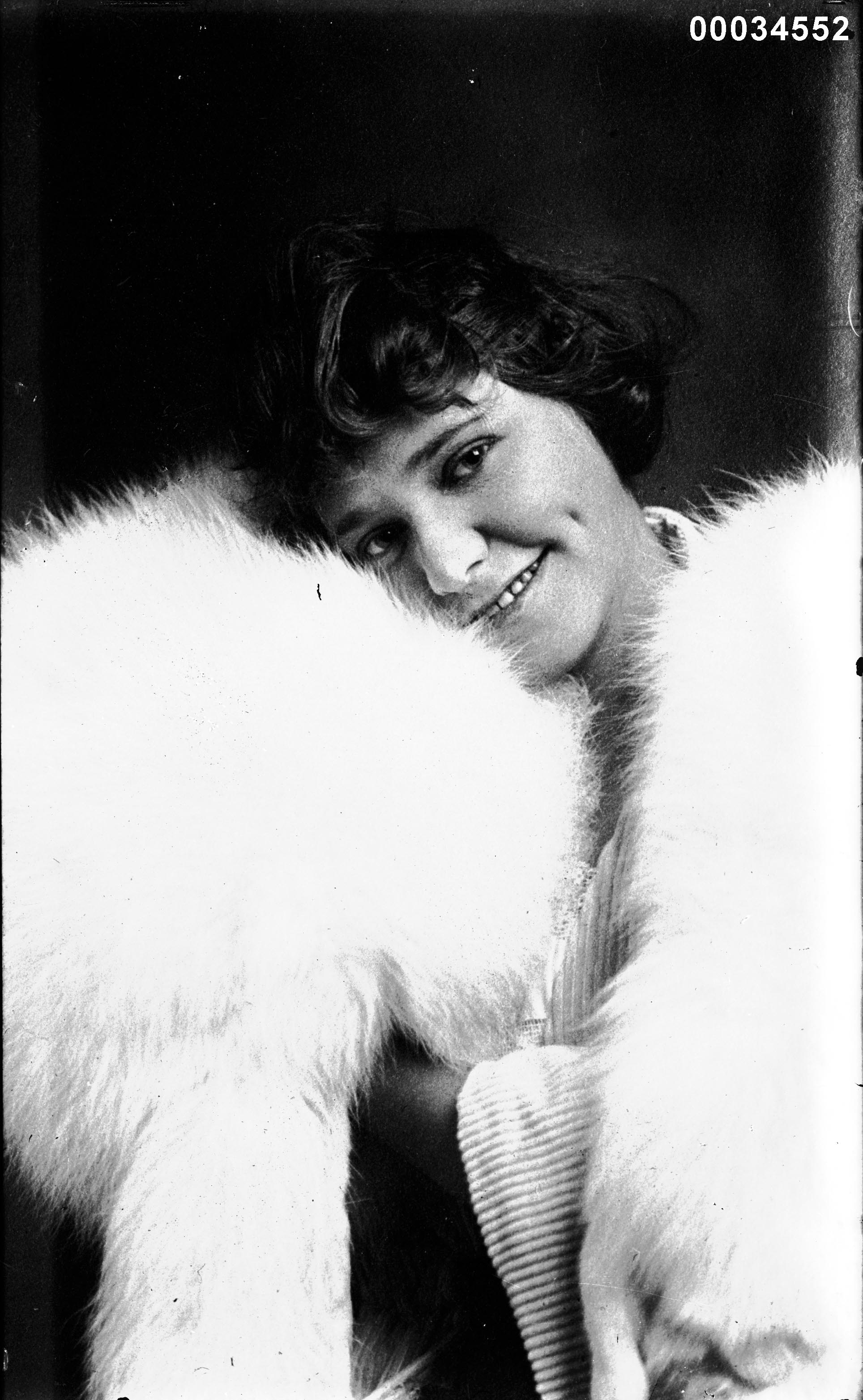 Portrait of a girl wearing a fur shawl, 1910-1930