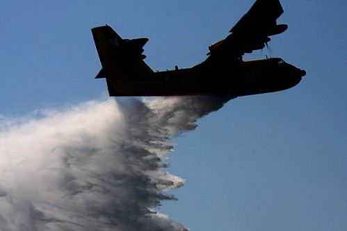 Fire fighting aircraft dropping sea water on a forest fire near Thessaloniki, Greece by Teacher Dude's BBQ