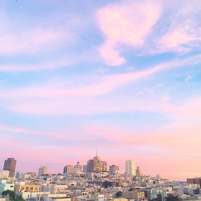 Up on the rooftop with cotton candy clouds.