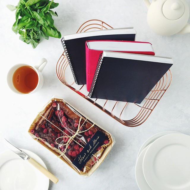 I had just finished shooting for the day and made a pot of tea when there was a knock at the door...   The @freedom_australia copper basket may have shown up with a @flourandstone Choc-Raspberry Buttermilk Cake in it, but I have a thing for notebooks, and