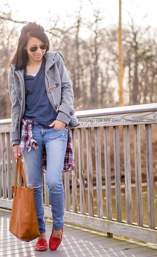gray toggled coat, navy tee, plaid shirt, cognac brown tote, red loafers