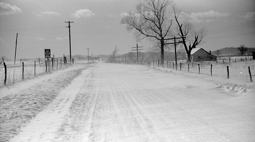 road county wood trees winter ohio house snow storm mountains film sign pen fence landscape arthur ross log scenery telephone 1940 fences twin scene historic hills photograph single scanned wpa poles siding residence us50 township dwelling topography onestory rothstein ushighway50