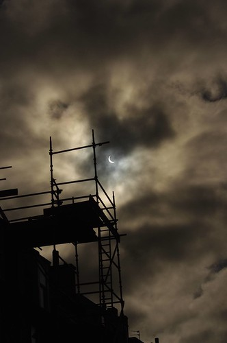 Scaffolding and Crescent Sun