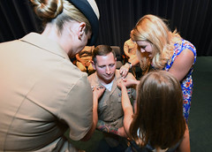 U.S. Pacific Fleet Sailor of the Year, Hospital Corpsman 1st Class Corey Smith, has his Chief Petty Officer anchors pinned on during a ceremony May 12 where the U.S. Navy's Sailors of the Year were meritoriously advanced. (U.S. Navy/MC1 Martin L. Carey)