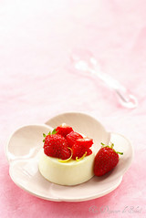 Panna cotta with lemon, strawberries and olive oil