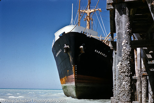 "MV ""Kabbarli"" sitting on the mud at the old Broome Jetty in 1962"