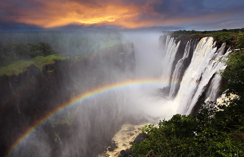 africa morning travel sunset vacation orange holiday tourism nature water clouds river spectacular landscape waterfall rainbow warm postcard atmosphere falls spray foam victoriafalls dramaticsky idyllic atmospheric pleasant zambia morningsky zambezi enjoyable scenicview zambeziriver dramaticlandscape