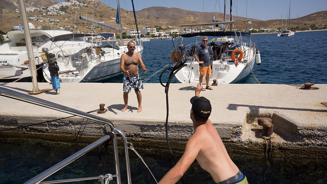 Andrew throwing a line for our first Med mooring - Livadi Harbour on Serifos