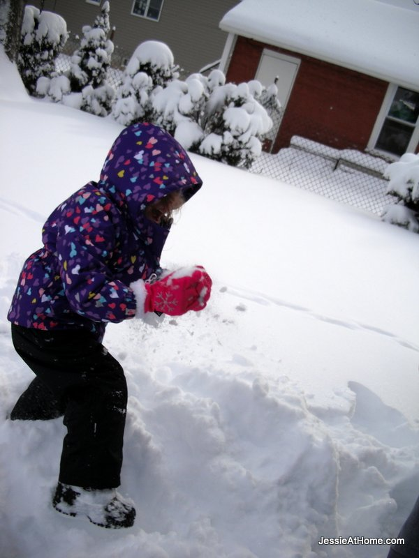 Kyla-making-a-snow-ball