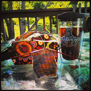 Lovely afternoon on the deck! #knitting on my #alaska #socks with an iced cold #dietcoke in my favorite #bruins #tervis cup while the dogs lounge #lifeisgood