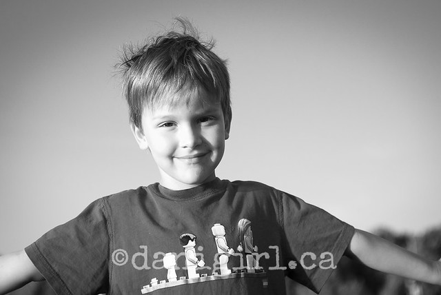 playful portrait of little boy on the beach