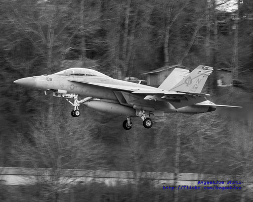 ZOOM ON A BLACK ACES' JET ON FINAL TO BOEING FIELD IN BLACK & WHITE