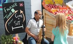 Watching a musician at Fawkner piazza