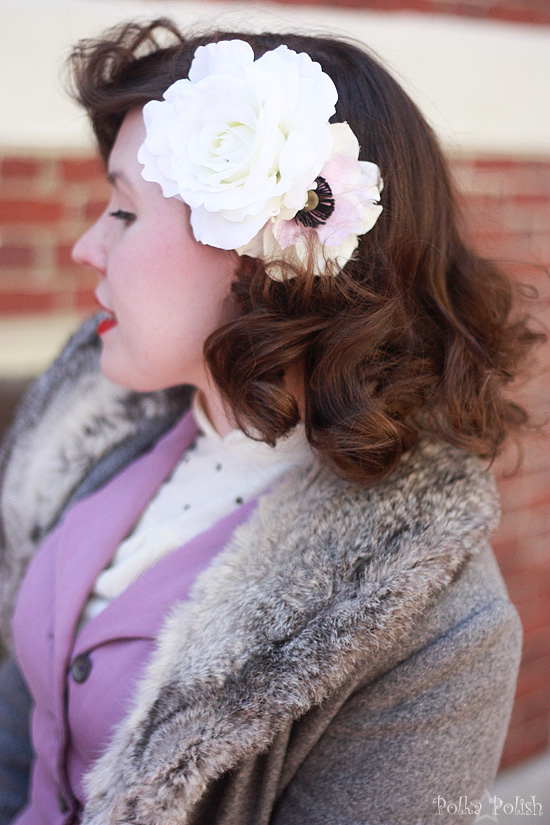 Closeup of fur collar and white silk roses