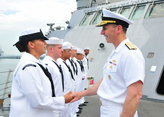 Chief of Naval Operations (CNO) Adm. Jonathan Greenert shakes hands with Boatswains Mate 1st Class Joyce Flynn during an all-hands call aboard the littoral combat ship USS Freedom (LCS 1) in Singapore, May 14. (U.S. Navy photo by Mass Communication Specialist 1st Class Cassandra Thompson)