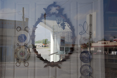 A mirror displayed in a shop window in Bartlett, Texas.