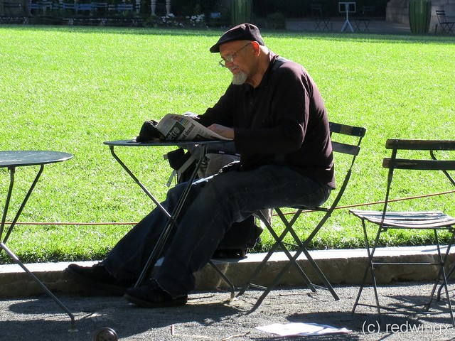 Bryant Park reading paper