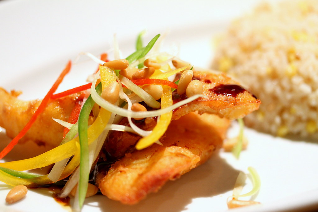mezza9: crispy fried cod fish drizzled with szechuan sauce and served garlic-egg-fried rice