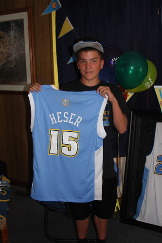 Heser holding a jersey