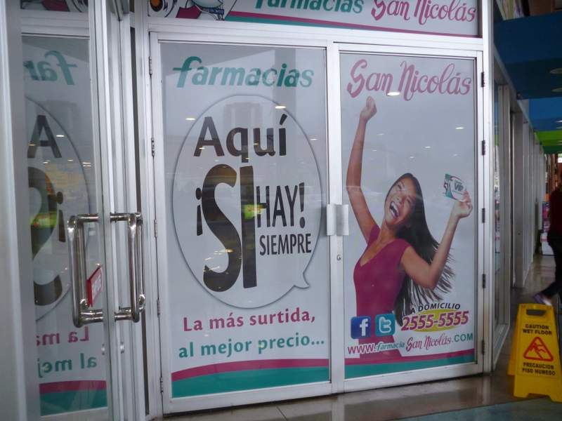 Overexposed Model in a pharmacy ad in San Salvador
