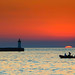 Ship in harbour with sunset - Enjoying the peace of the sea by Dragos Cosmin- Getty Images Artist