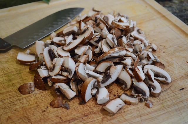 A pile of chopped cremini mushrooms.