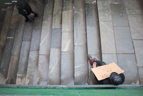 Moscow, homeless on the stairs subway entrance