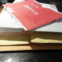 A monday outgoing pile of a dozen sticker packs... and Fargo disc1.