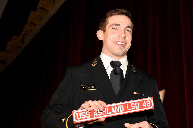 ANNAPOLIS, Md. - U.S. Naval Academy Midshipman 1st Class Joshua Malone celebrates after choosing the Whidbey Island-class dock landing ship, USS Ashland (LSD 48) during Ship Selection Night in Mahan Hall.