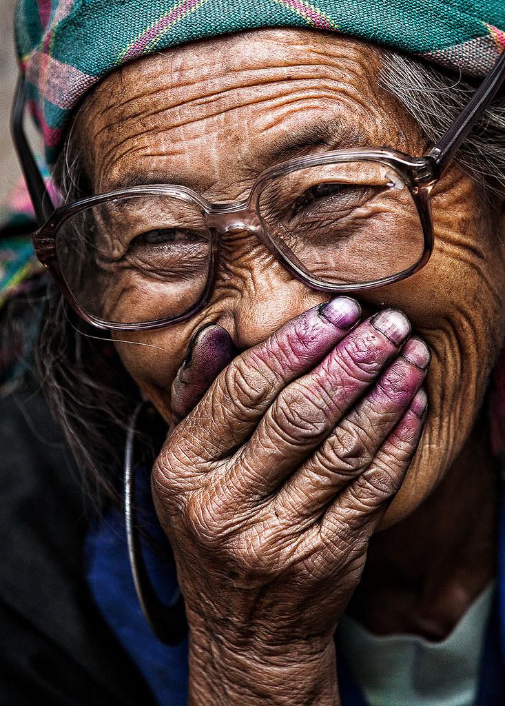 old-woman-hidden-smile-portrait