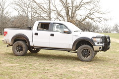 ford f-550(0.0), automobile(1.0), automotive exterior(1.0), pickup truck(1.0), wheel(1.0), vehicle(1.0), truck(1.0), ford super duty(1.0), bumper(1.0), land vehicle(1.0),
