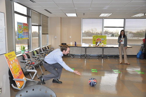 Worksite wellness events encourage employees to eat healthy and be active, building healthy habits that can be maintained beyond the work day! Shown here a USDA employee participates in a MyPlate relay activity.