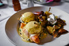 Eggs Benny w/ Smoked Salmon, Caper Hollandaise, Served w/ Home Fries, and Chorizo - Cafe Bacchus