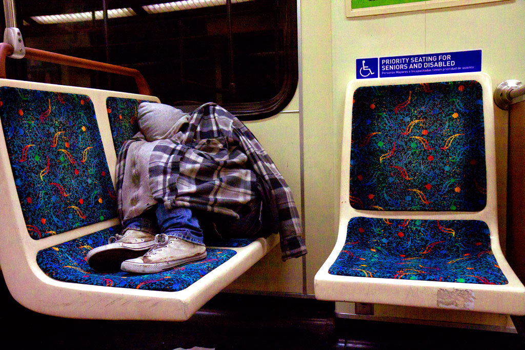 Young-man-sleeping-on-subway-train-in-3-13--Los-Angeles