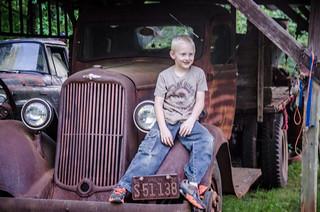 Joshua on an old truck