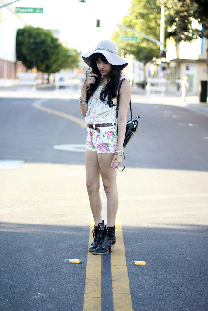 Tarte Vintage high waist denim floral hot shorts, lace crop top, 90's backpack, scalloped bra, floppy hat shoptarte.com