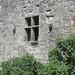 Fenêtre à croisée de pierre, ancien logis (XVe) de la Commanderie de l'ordre des Hospitaliers de Malte, Roquebrune, Entre-Deux-Mers, Gironde, Aquitaine, France. ©byb64