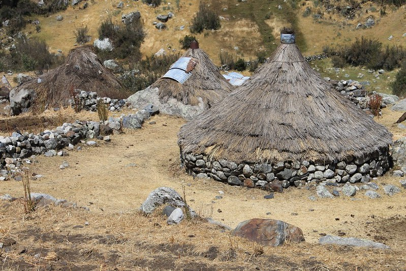 Stone and thatch shacks in Quebrada Shallap