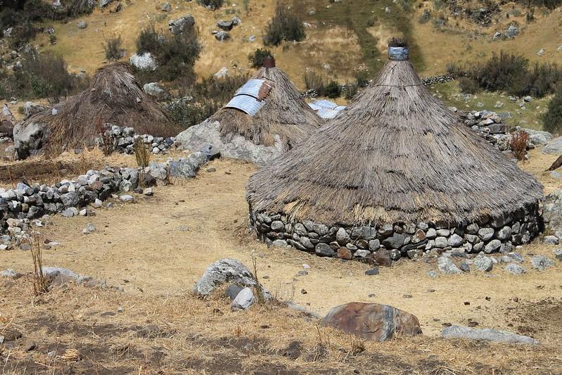 Stone and thatch shacks in Quebrada Shallap