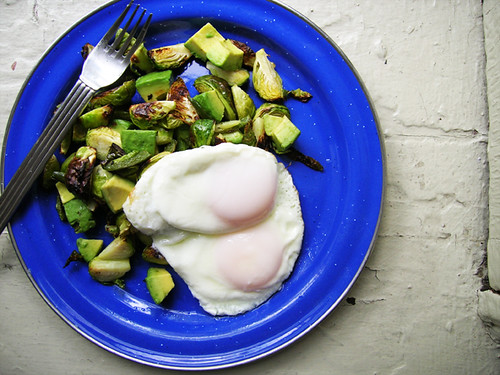 fried eggs with brussels sprout, jalapeno, and avocado hash