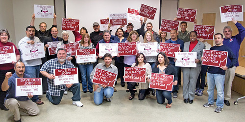 CWAers and allies from at least 20 organizations hold a town hall meeting near Sacramento, Calif., calling on Reps. Ami Bera and Doris Matsui to vote NO on Fast Track.
