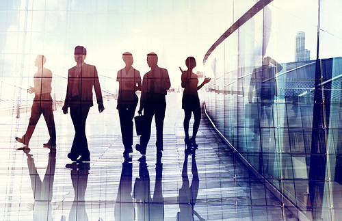 Silhouettes of Business People Walking in the Office