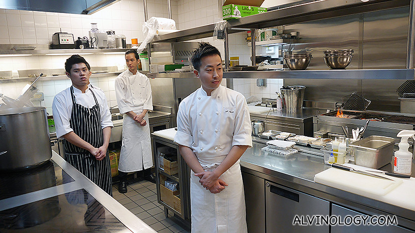 The chefs all stopped and stood still when Chef Wakuda entered the kitchen