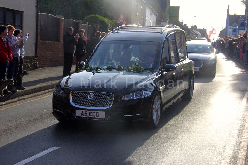 The hearse carrying the remains of King Richard III makes its way through the Leicestershire village of Desford