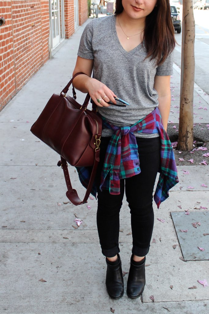 plaid shirt tied around waist