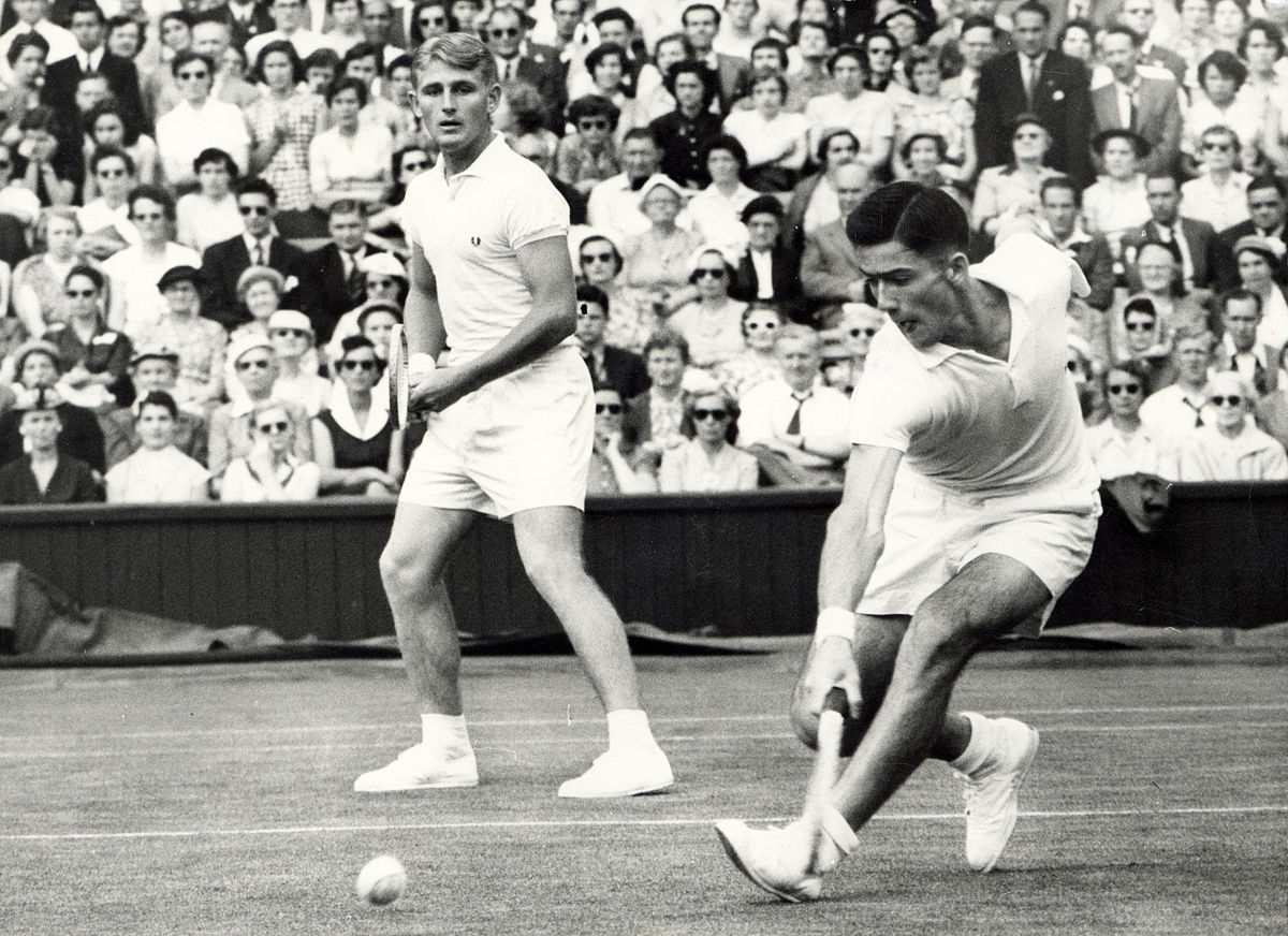 Rosewall (right) and Hoad playing doubles at the Wimbledon Championships in the 1950s